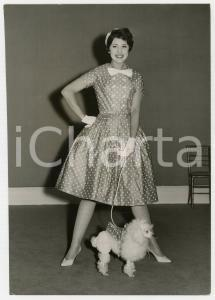 1958 LONDON Ascot Models' Spring collection - Model posing with a poodle *Photo