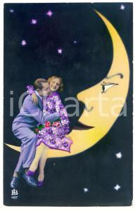 1920 ca COUPLE Lovers sitting on a crescent moon - Embossed postcard