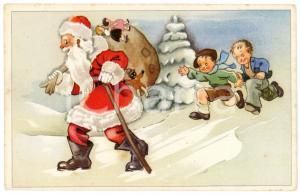 1910 ca CHRISTMAS - Santa Claus walking in the snow with children - Postcard