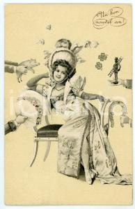 1904 BONNE ANNÉE Woman sitting in a sofa with good luck sign *Glittered postcard