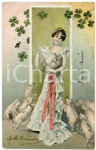 1911 BONNE ANNÉE - Woman surrounded by pigs - DAMAGED Postcard