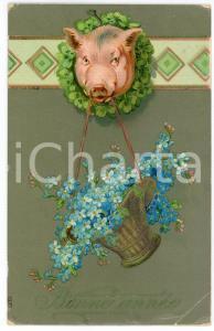 1909 BONNE ANNÉE Pig holding a basket of flowers - Embossed postcard