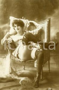 1910 ca VINTAGE EROTIC Woman in stockings on an easy chair  - Postcard risque GP