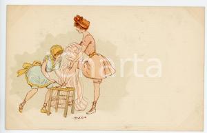 1900 ca CHILDREN Girls lacing up dance shoes - Artist MARS Postcard FP NV