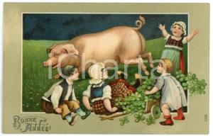 1910 BONNE ANNÉE Children playing with lucky pig - Illustrated embossed Postcard