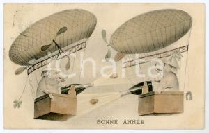 1909 BONNE ANNEE Flying pigs on airships spraying champagne - Vintage postcard